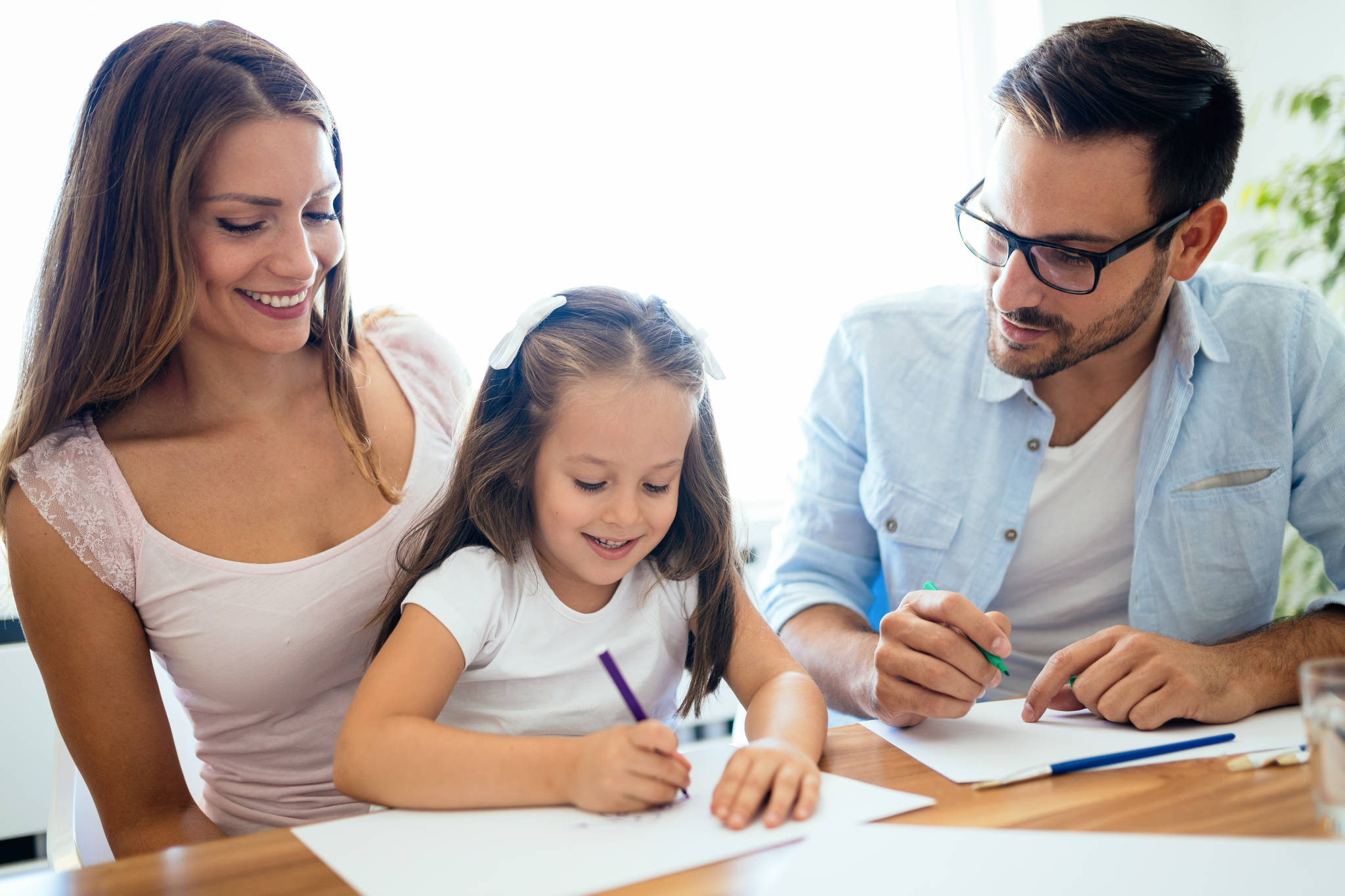 Parents and child doing homework